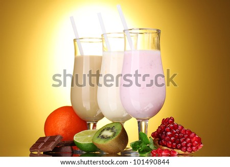Milk shakes with fruits and chocolate on brown background