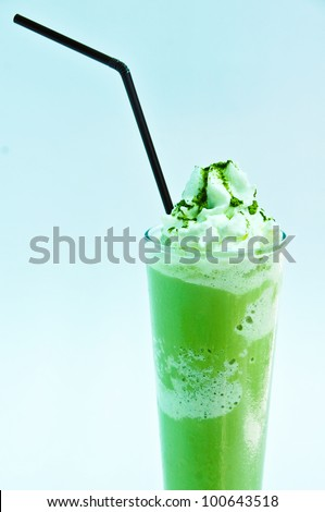 Milk shakes with green tea isolated on white and blue - stock photo