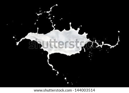 milk splash isolated on black background - stock photo