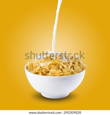 Milk Splash on Bowl of Cereal Corn Flakes - stock photo