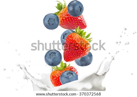 Milk Splash with Strawberries And Blueberries