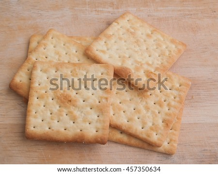 Milk square crackers on wooden background,snack for healthy