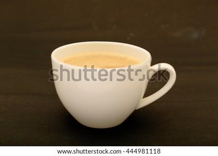 Milk tea cup in black background. - stock photo