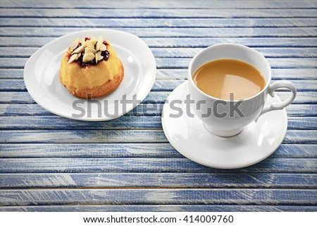 Milk tea with a dessert on wooden background. - stock photo