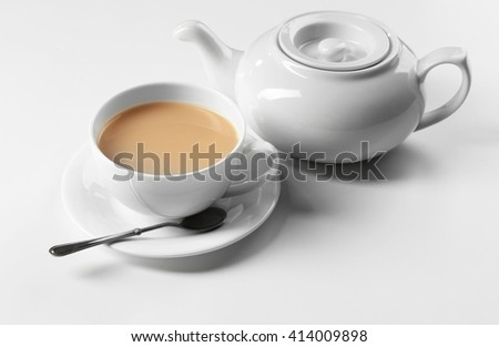 Milk tea with tea pot on white background - stock photo