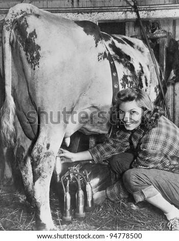 Milking time on the farm - stock photo