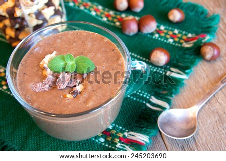 Milkshake (chocolate smoothie) in bowl with mint, nuts and homemade cookies, breakfast horizontal close up - stock photo