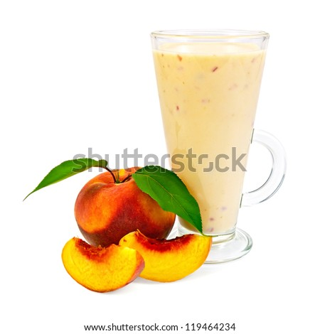 Milkshake in a glass beaker with peaches and green leaves it is isolated on a white background - stock photo