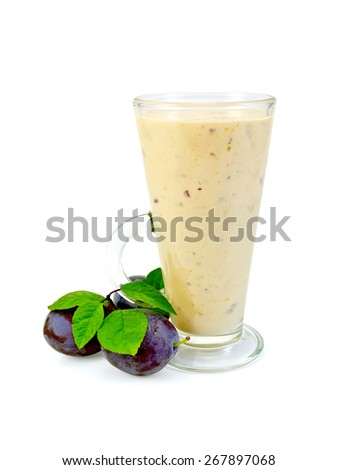 Milkshake in a glass, black plum with green leaves isolated on white background - stock photo