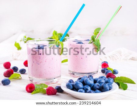 Milkshake with blueberries, raspberries and mint - stock photo