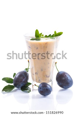 milkshake with whipped fresh plums on a white background - stock photo
