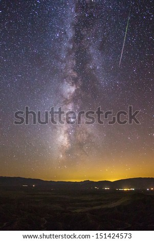 Milky way and a Perseid meteor in the desert.