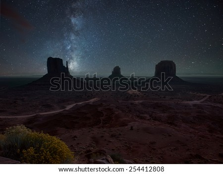 Milky Way and bright stars above Monument Valley. USA - stock photo
