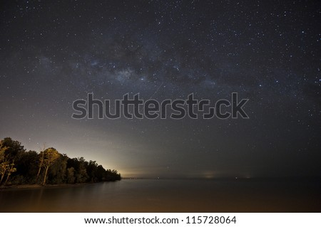 milky way and the sea - stock photo