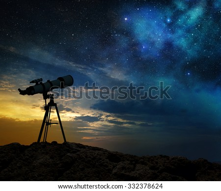 milky way at dawn and silhouette of a telescope - stock photo