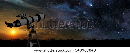 milky way at sunset and telescope in the foreground - stock photo