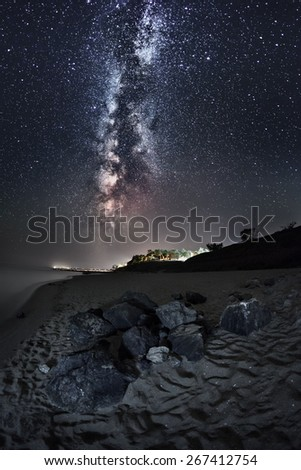 Milky Way. Beautiful summer night sky on the beach in Ukraine. Trail and stone - stock photo