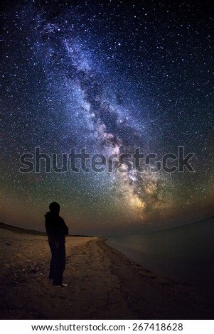 Milky Way. Beautiful summer night sky with stars and silhoette on the sea in Ukraine - stock photo