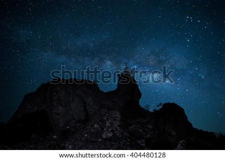 milky way behind a rock cliff  - stock photo
