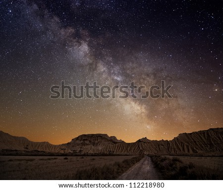 Milky Way over the desert of Bardenas, Spain - stock photo