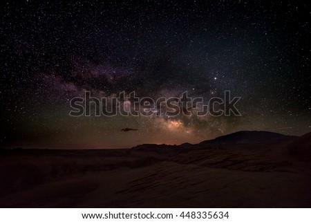 Milky Way rising behind Navajo Mountain Utah - stock photo