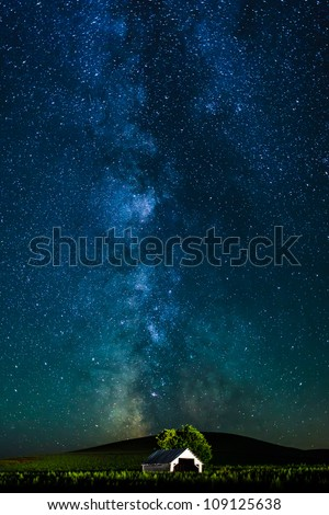 Milky Ways over the white hut - stock photo