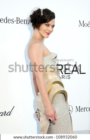Milla Jovovich arriving for AmfAR's Cinema Against Aids gala 2012 during the 65th annual Cannes Film Festival Cannes, France - 24.05.12 Henry Harris - stock photo