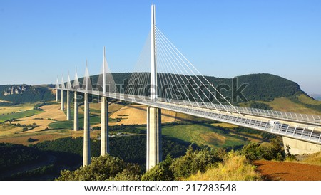 MILLAU, FRANCE - JUNE 20, 2014: Millau Viaduct. Millau Viaduct designed by the French structural engineer Michel Virlogeux and British architect Norman Foster, it is the tallest bridge in the world.  - stock photo