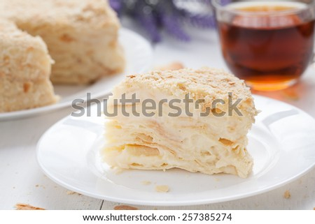 Mille-feuille slice cake in vintage provence style background with tea