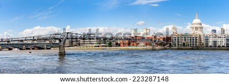 Millennium bridge and St Paul cathedral panorama in London  - stock photo