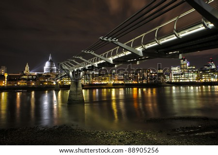 Millennium Bridge and st.Paul's Cathedral at night - stock photo