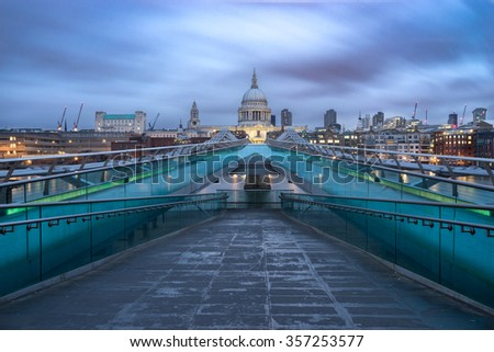Millennium bridge and St.Paul's cathedral viewed at sunrise in London, England