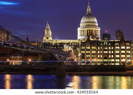 Millennium Bridge leading to Saint Paul's Cathedral during sunset in central London, UK - stock photo