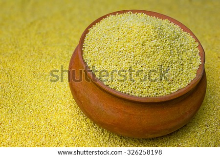 millet in a clay pot - stock photo