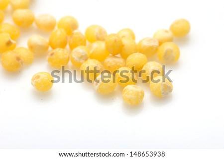millet on a white background. macro - stock photo