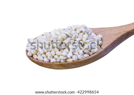 Millet rice, buckwheat in wooden spoon over white background, Selective focus - stock photo