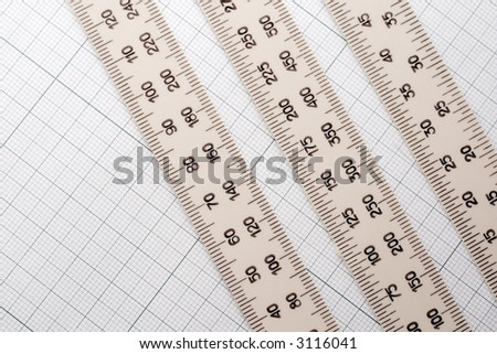 millimeter paper and different scale meter - stock photo