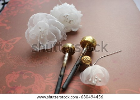 Millinery hat making tools silk flowers stock photo download now millinery and hat making tools silk flowers and thimble mightylinksfo