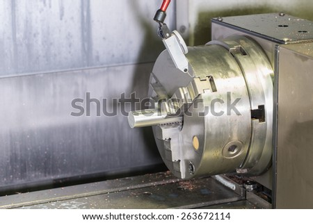 milling detail on metal cutting cnc machine with raw metal material tube - stock photo