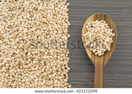 Millo cereal seeds on wooden table