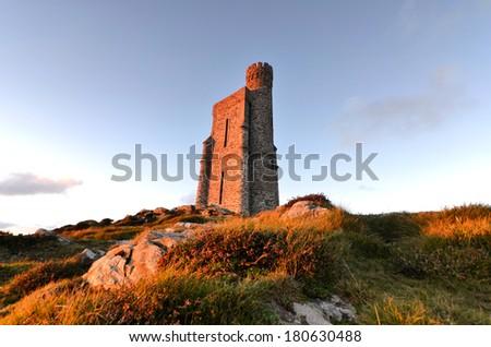 Milner Tower on Brada Head, Isle of Man, UK. Sunset tranquil scene - stock photo