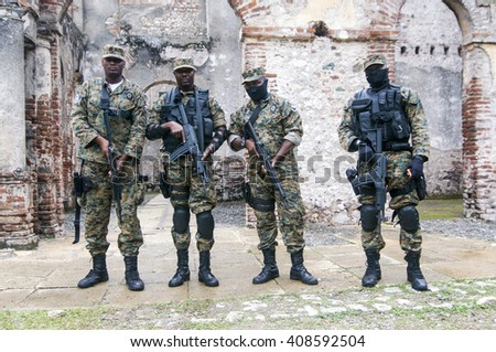 MILOT, HAITI - NOV 17, Fully armed soldiers guarding Sans Souci palace during president Michel Martelly visit on November 17, 2013 in Milot, Haiti. - stock photo