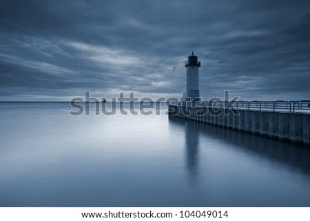 Milwaukee Lighthouse. Toned image of the Milwaukee Lighthouse at sunset. - stock photo