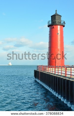 Milwaukee Pierhead Lighthouse With Breakwater Light in the Distance (Located on Lake Michigan in Wisconsin) - stock photo