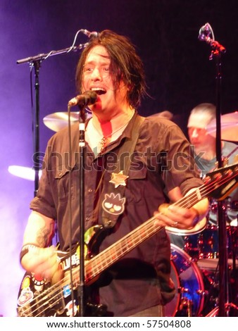 MILWAUKEE, WI - MAY 15: Robby Takac performs with the Goo Goo Dolls at the Pabst Theater in Milwaukee, WI on May 15, 2010 as part of the Something for the Rest of Us World Tour. - stock photo