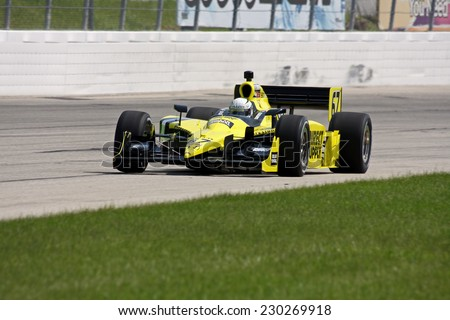 Milwaukee Wisconsin, June 17, 2011: Indycar Indyfest race Milwaukee Mile, Ed Carpenter-USA, Dollar General - Sarah Fisher Racing team - stock photo