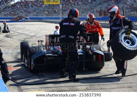 Milwaukee Wisconsin, USA - August 17, 2014: Verizon Indycar Series Indyfest ABC 250 Crew races to change tires and refuel the car. 3 Helio Castroneves Sao Paulo, Brazil Hitachi Team Penske Chevrolet