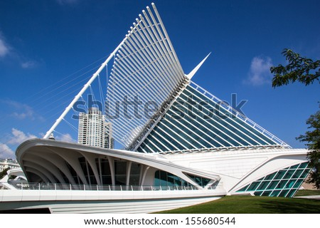 "MILWAUKEE, WISCONSIN,USA-SEPTEMBER 25:The Milwaukee Art museum welcomes visitors on September 25, 2013. The ""wings"" of this unique building fold and unfold twice daily. - stock photo"