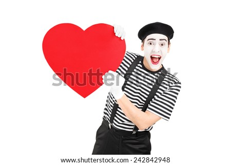 Mime artist holding a big red heart isolated on white background - stock photo