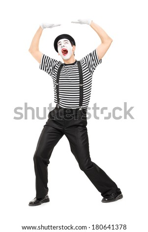 Mime artist simulate carrying something over his head isolated on white background - stock photo